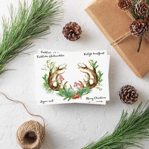 Weihnachtspostkarte Geweih Grüße